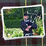 Bagpiper in South Wales - John Campbell - thumbnail image